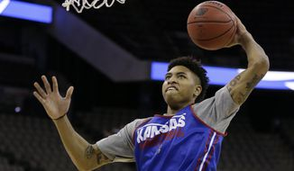 Kansas guard Kelly Oubre Jr. drives to the basket during practice for an NCAA college basketball tournament second round game, Thursday, March 19, 2015, in Omaha, Neb. Kansas plays New Mexico State on Friday. (AP Photo/Charlie Neibergall)