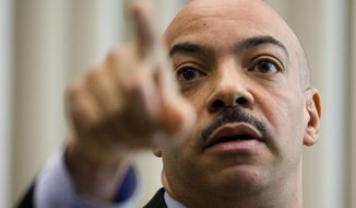 Philadelphia District Attorney Seth Williams gestures during a news conference Thursday, March 19, 2015, in Philadelphia. Williams says the fatal December 2014 police shooting of Brandon Tate-Brown during an early morning traffic stop was a tragedy but not a crime. (AP Photo/Matt Rourke)
