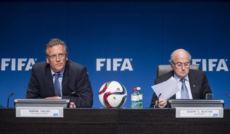 FIFA President Joseph Blatter, right, and Secretary General, Jerome Valck, left,  attend a press conference following the FIFA Executive Committee meeting in Zurich, Switzerland, on Friday, March 20, 2015. Among many topics, the Committee discussed the 2022 FIFA World Cup in Qatar. (AP Photo/Keystone,Ennio Leanza)