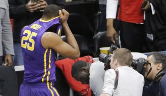 LSU's Jordan Mickey (25) leaves the court after his team lost 66-65 to North Carolina State in an NCAA tournament second round college basketball game, Thursday, March 19, 2015, in Pittsburgh. (AP Photo/Gene J. Puskar)