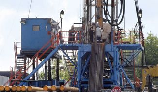 FILE - In this June 25, 2012 file photo, a crew works on a gas drilling rig at a well site for shale based natural gas in Zelienople, Pa. The Obama administration is requiring companies that drill for oil and natural gas on federal lands to disclose chemicals used in hydraulic fracturing operations. A final rule released Friday also updates requirements for well construction and disposal of water and other fluids used in fracking, a drilling method that has prompted an ongoing boom in natural gas production. (AP Photo/Keith Srakocic, File)