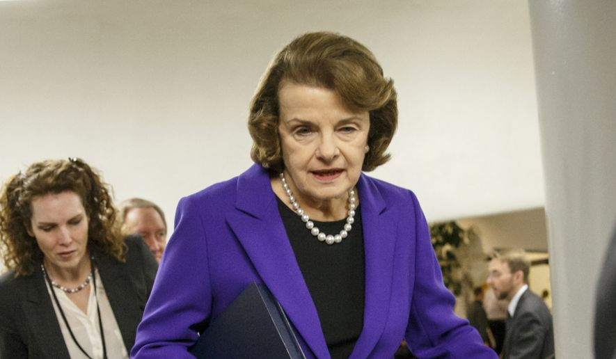 Sen. Dianne Feinstein, D-Calif., is pursued by reporters on Capitol Hill in Washington in this Dec. 9, 2014, file photo. (AP Photo/J. Scott Applewhite, File)