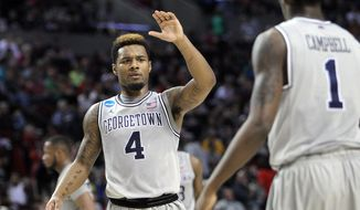 Georgetown guard D'Vauntes Smith-Rivera, left, high-fives teammate Tre Campbell during the second half of an NCAA college basketball second round game against Eastern Washington in Portland, Ore., Thursday, March 19, 2015. (AP Photo/Craig Mitchelldyer)