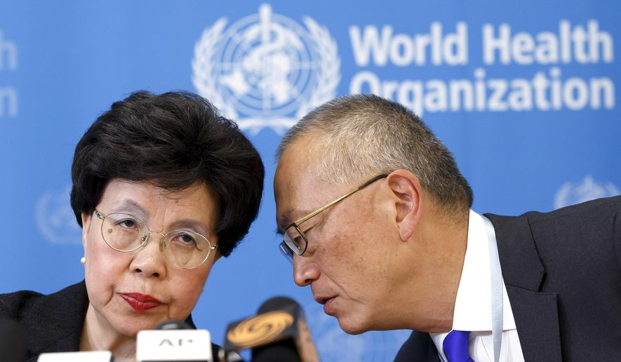Director-General of the World Health Organization (WHO) Dr. Margaret Chan, left, and Assistant Director-General of Health Security Keiji Fukuda, right, confer during a news conference after an emergency meeting at the WHO headquarters in Geneva, Switzerland, in this Friday, Aug. 8, 2014, file photo. (AP Photo/Keystone, Salvatore Di Nolfi, File)