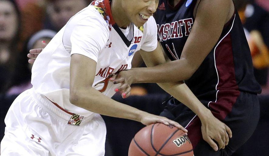 Maryland guard Brene Moseley, left, drives around New Mexico State guard Shanice Davis in the first half of an NCAA college basketball game in the first round of the NCAA tournament, Saturday, March 21, 2015, in College Park, Md. (AP Photo/Patrick Semansky)