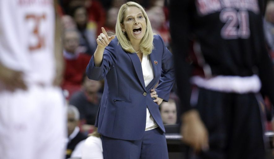 Maryland head coach Brenda Frese directs her players in the first half of an NCAA college basketball game against New Mexico State in the first round of the NCAA tournament, Saturday, March 21, 2015, in College Park, Md. (AP Photo/Patrick Semansky)
