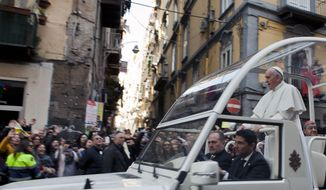 Pope Francis waves to faithful as he arrives for a meeting with young people in Naples, Italy, Saturday, March 21, 2015. Francis is on a one-day visit to Naples and Pompeii. (AP Photo/Roberta Basile)
