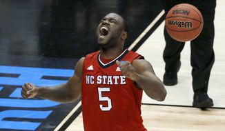 North Carolina State's Desmond Lee (5) celebrates after defeating Villanova in an NCAA college basketball tournament Round of 32 game Saturday, March 21, 2015, in Pittsburgh. North Carolina State won 71-68 to advance to the Sweet 16 round. (AP Photo/Gene J. Puskar)