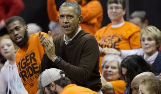 President Barack Obama cheers at the Princeton game against Wisconsin-Green Bay women's college basketball game in the first round of the NCAA tournament in College Park, Md., Saturday, March 21, 2015. Obama's niece Leslie Robinson, plays for Princeton.(AP Photo/Pablo Martinez Monsivais)