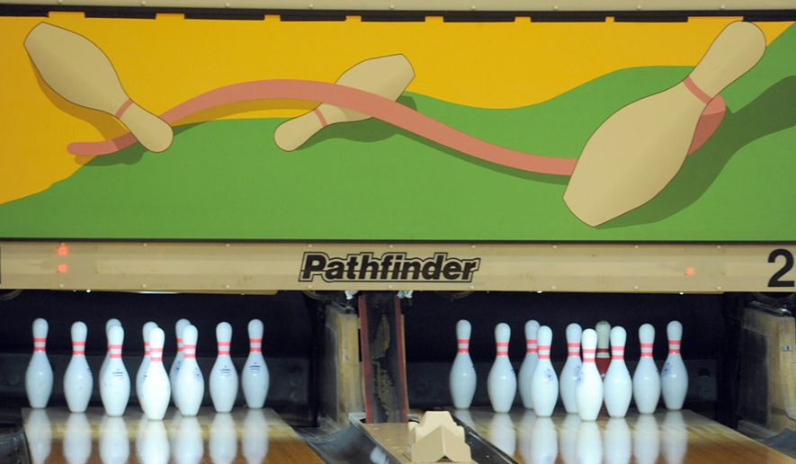MEMBER EXCHANGE ADVANCE FOR SATURDAY, MARCH 21, 2015 - In this Friday, March 6, 2015 photo the Crosswinds Activity Center, a recreation and bowling center at Air Station Cape Cod, displays new art above the pins in Bourne, Mass. The lanes have undergone renovations and are ready for bowlers. (AP Photo/Cape Cod Times, Merrily Cassidy)