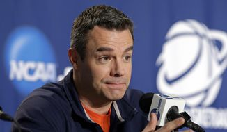 Virginia head coach Tony Bennett answers a question during a news conference at an NCAA college basketball tournament in Charlotte, N.C., Saturday, March 21, 2015. Virginia plays Michigan State in the Round of 32 on Sunday. (AP Photo/Chuck Burton)