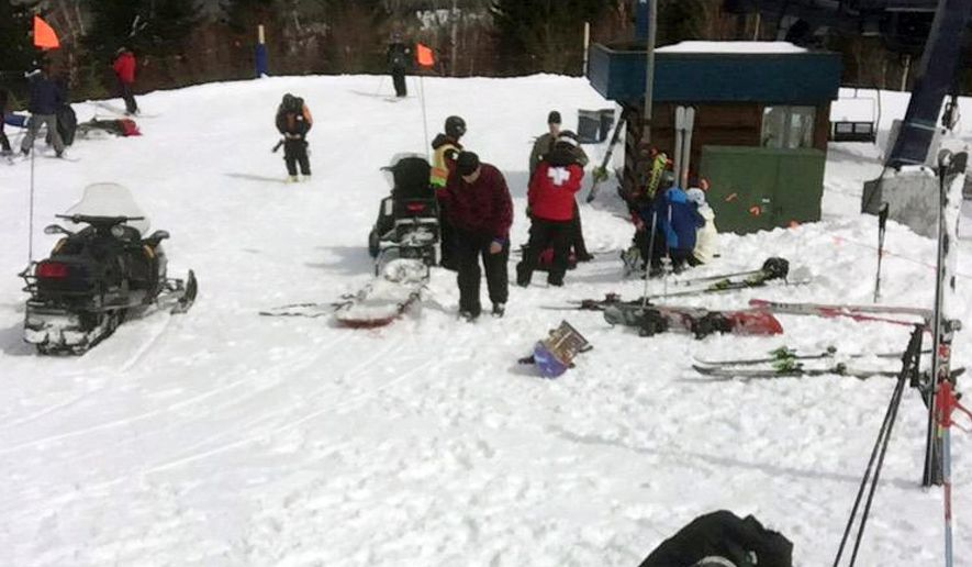 In this photo provided by Greg Hoffmeister, first aid is administered to injured skiers at Sugarloaf Mountain Resort after a chairlift accident on Saturday, March 21, 2015, in Carrabassett Valley, Maine. Seven people were hurt when an out-of-control chair lift at Sugarloaf ski resort stopped and then headed down the mountain backward, prompting riders to jump off, officials and witnesses said. (AP Photo/Greg Hoffmeister)