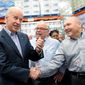Vice President Joseph R. Biden visited Costco CEO Craig Jelinek (right) and co-founder Jim Sinegal when the retailer opened a store in the District in 2012. Costco is seen as a political company, often praised by President Obama and his administration, and the effect on employees is uncertain. (Associated Press)