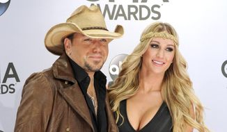 In this Nov. 5, 2014, file photo, Jason Aldean, left, and Brittany Kerr arrive at the 48th annual CMA Awards at the Bridgestone Arena in Nashville, Tenn. A representative for Aldean confirmed that the couple married Saturday, March 21, 2015, in Mexico. They announced their engagement in September. (Photo by Evan Agostini/Invision/AP)