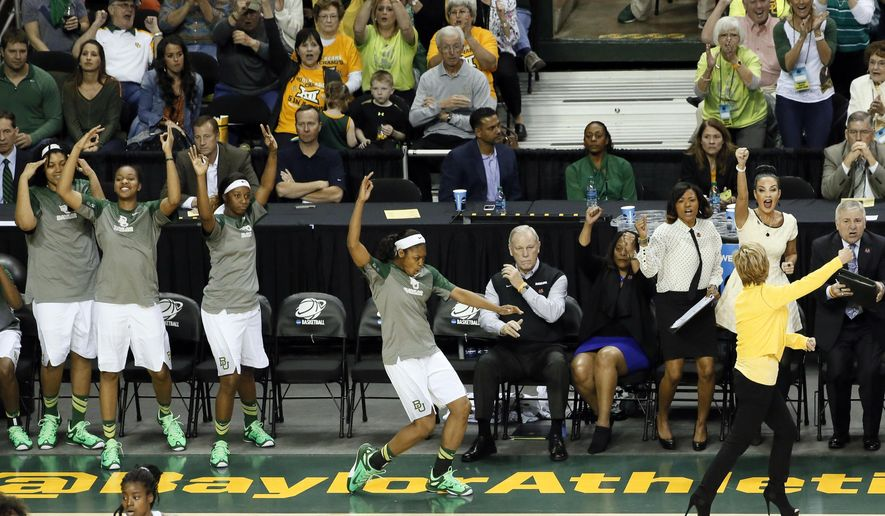 The Baylor bench, led by head coach Kim Mulkey front right, celebrate a 3-point basket against Arkansas in the second half of a women's college basketball game in the second round of the NCAA tournament Sunday, March 22, 2015, in Waco, Texas. Baylor won 73-44. (AP Photo/Tony Gutierrez)
