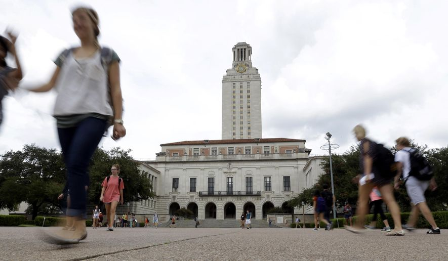 In this Sept. 27, 2012, photo, students walk through the University of Texas at Austin campus near the school's iconic tower in Austin, Texas. (AP Photo/Eric Gay) **FILE**