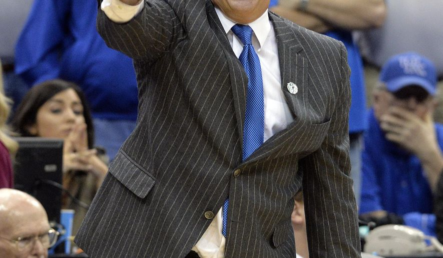Kentucky head coach John Calipari shouts instructions to his team during the second half of an NCAA tournament college basketball game in Louisville, Ky., Saturday, March 21, 2015. Kentucky won 64-51. (AP Photo/Timothy D. Easley)