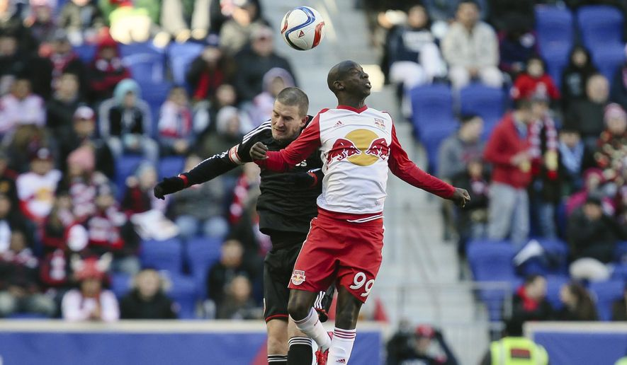 D.C. United defender Bobby Boswell, left, and New York Bulls' Bradley Wright-Phillips (99) vie for a header during the first half of an MLS soccer game, Sunday, March 22, 2015, in Harrison, N.J. (AP Photo/John Minchillo)