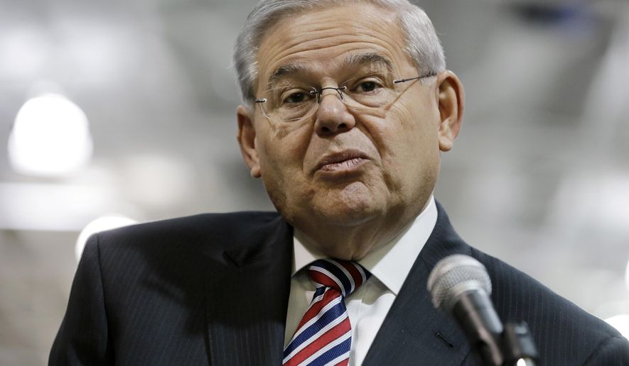 U.S. Sen. Robert Menendez, D-NJ, listens to a question while addressing a gathering Monday, March 23, 2015, in Garwood, N.J. Menendez listened to questions about the possible filing of corruption charges against him. (AP Photo/Mel Evans)