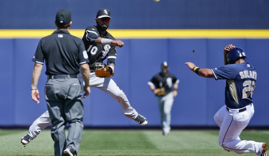 Chicago White Sox shortstop Alexei Ramirez fires throw over San Diego Padres' Yangervis Solarte while completing a double play in the first inning of a spring training baseball game Monday, March 23, 2015, in Peoria, Ariz.  (AP Photo/Lenny Ignelzi)