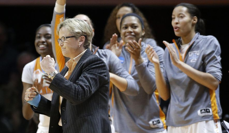 Tennessee head coach Holly Warlick and players on the bench celebrate after a basket against Pittsburgh during the first half of a college basketball game in the second round of the NCAA women's tournament Monday, March 23, 2015, in Knoxville, Tenn. Tennessee won 77-67. (AP Photo/Mark Humphrey)