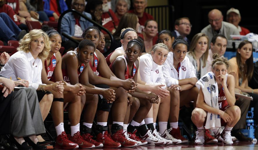 Oklahoma players watch from the bench in the closing minutes of a college basketball game against Stanford in the second round of the NCAA tournament Monday, March 23, 2015, in Stanford, Calif. (AP Photo/Marcio Jose Sanchez)