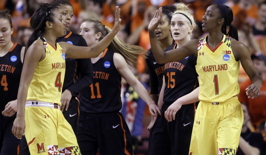 Maryland guard Lexie Brown, left, high-fives teammate Laurin Mincy after Mincy was fouled while shooting a basket in the first half of an NCAA college basketball game against Princeton in the second round of the NCAA tournament, Monday, March 23, 2015, in College Park, Md. (AP Photo/Patrick Semansky)