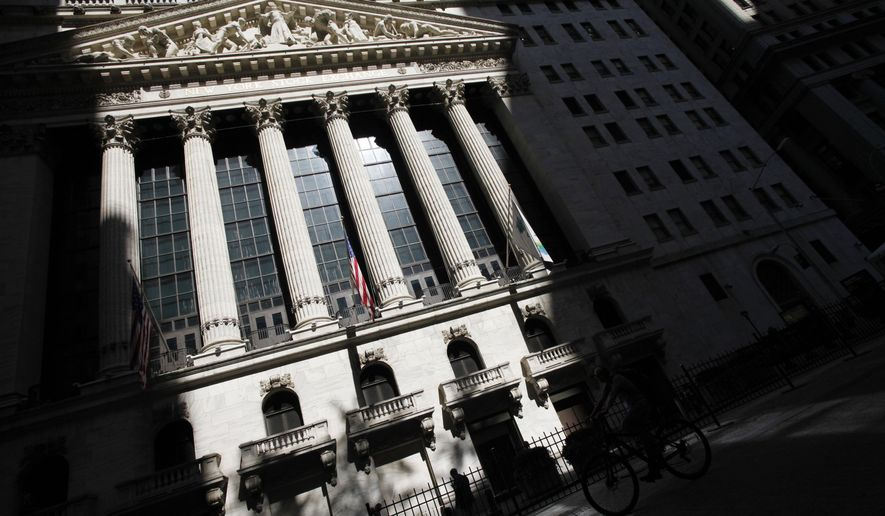 FILE - This July 15, 2013 file photo shows the New York Stock Exchange in New York. U.S. stock indexes are mixed in morning trading on Monday, March 23, 2015, following a strong performance last week. (AP Photo/Mark Lennihan, File)