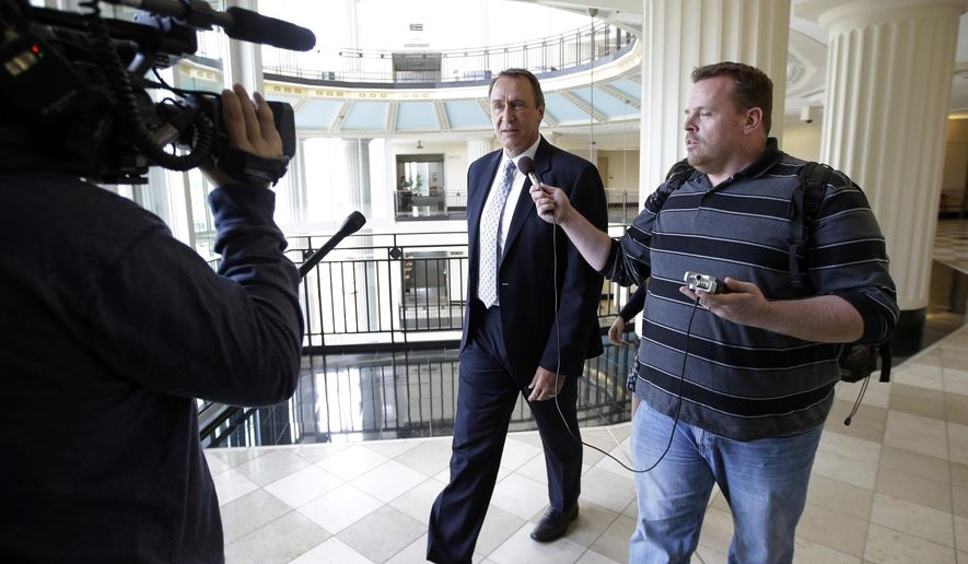 Former Utah Attorney General Mark Shurtleff arrives at court Monday, March 23, 2015, in Salt Lake City. Prosecutors are scheduled to lay out their evidence in the bribery case against Shurtleff this summer. A state judge on Monday scheduled a five day evidence hearing starting June 15. Shurtleff faces nine charges, including bribery, witness and evidence tampering and obstruction of justice. (AP Photo/Rick Bowmer)