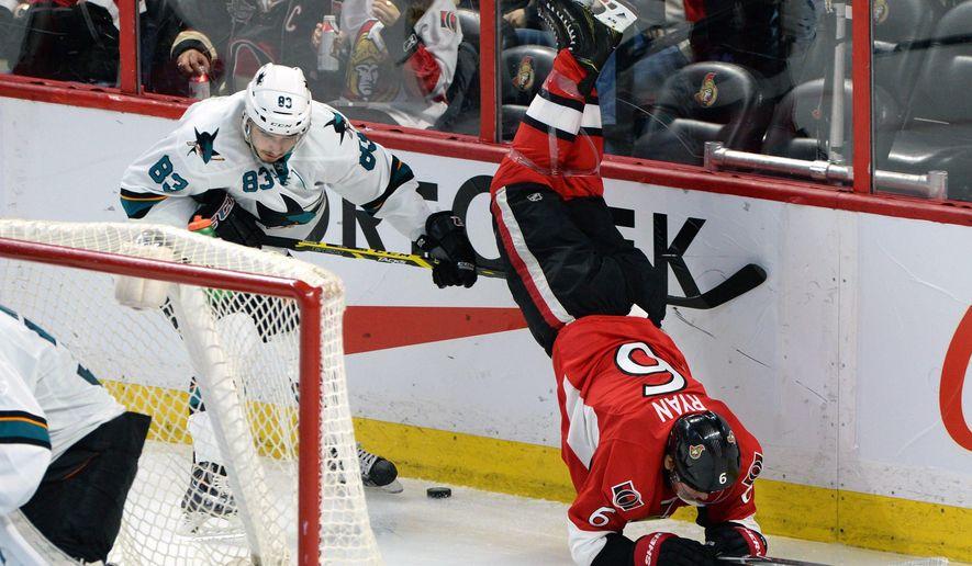 Ottawa Senators' Bobby Ryan (6) gets upended by San Jose Sharks' Matt Nieto during second period of an NHL hockey game in Ottawa, Ontario, Monday, March 23, 2015. (AP Photo/The Canadian Press, Sean Kilpatrick)