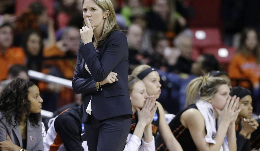 Princeton head coach Courtney Banghart walks near the bench in the second half of an NCAA college basketball game against Maryland in the second round of the NCAA tournament, Monday, March 23, 2015, in College Park, Md. Maryland won 85-70. (AP Photo/Patrick Semansky)