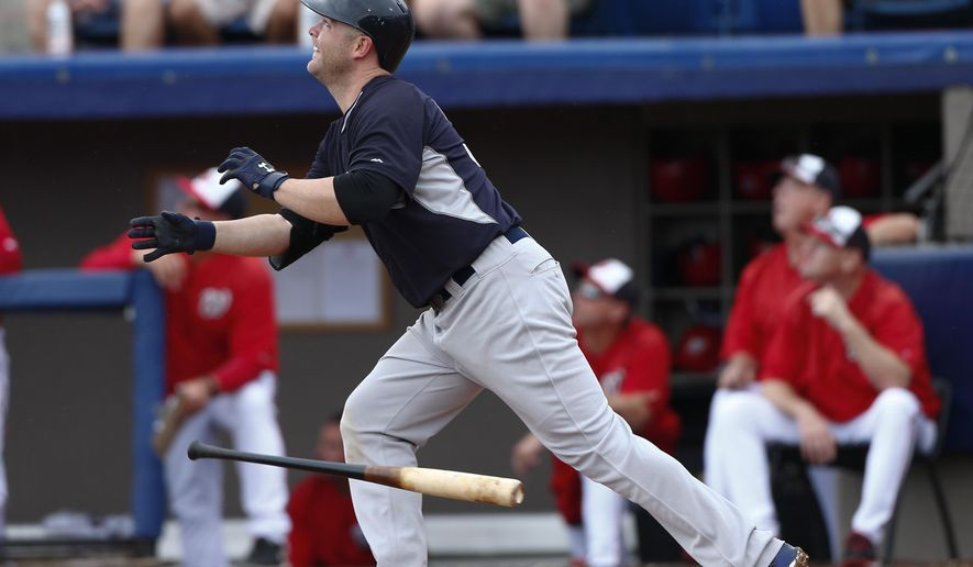 New York Yankees catcher Brian McCann (34)  follows through on a two-run home run in the third inning of an exhibition spring training baseball game against the Washington Nationals Monday, March 23, 2015, in Viera , Fla. (AP Photo/John Bazemore)