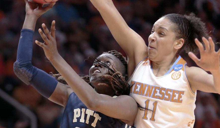 Pittsburgh forward Yacine Diop (12) shoots against Tennessee forward Cierra Burdick (11) during the first half of a college basketball game in the second round of the NCAA women's tournament Monday, March 23, 2015, in Knoxville, Tenn. (AP Photo/Mark Humphrey)