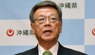 Okinawa Gov. Takeshi Onaga speaks during a news conference in Naha on the southern Japanese island of Okinawa Monday, March 23, 2015. Onaga has ordered a Defense Ministry branch to suspend all work at the site where a key U.S. military air base is to be relocated. Onaga told the news conference that a concrete anchor thrown into the sea for a drilling survey of the reef at the designated site known as Henoko is believed have damaged coral. (AP Photo/Kyodo News, Keiichiro Hoshino) JAPAN OUT, CREDIT MANDATORY