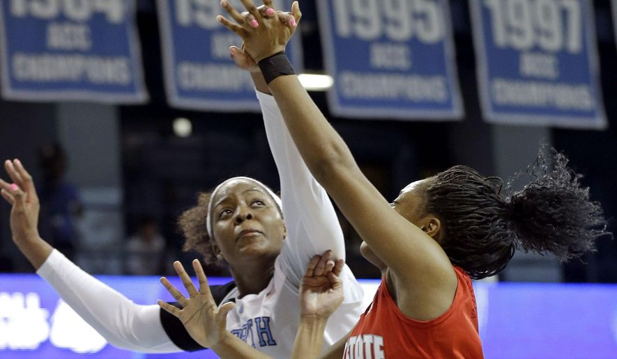 North Carolina's Stephanie Mavunga blocks Ohio State's Kelsey Mitchell (3) during the first half of a college basketball game in the second round of the NCAA tournament in Chapel Hill, N.C., Monday, March 23, 2015. (AP Photo/Gerry Broome)