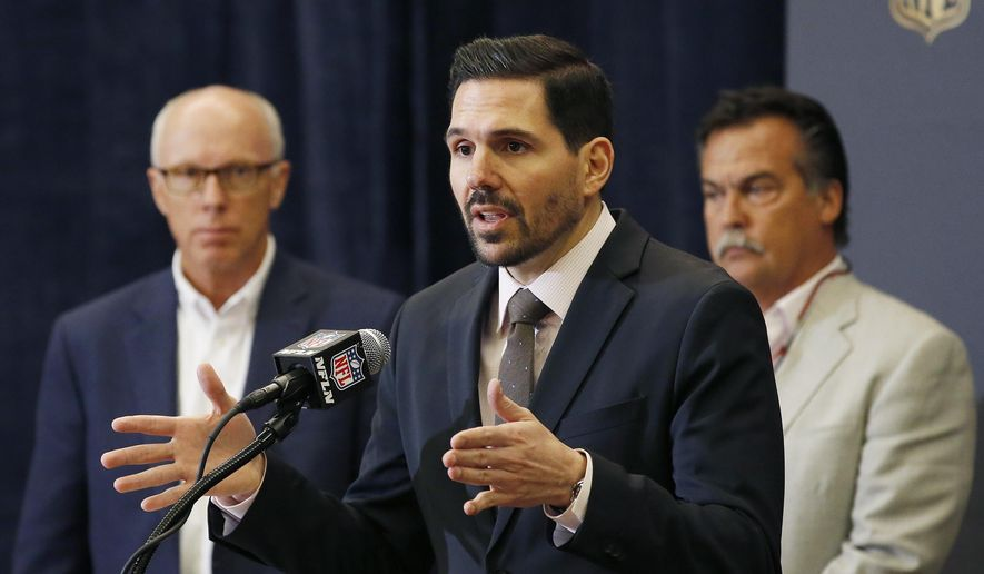 Dean Blandino, middle, NFL vice president of officiating, answers a question as Atlanta Falcons president and CEO Rich McKay, left, and St. Louis Rams head football coach Jeff Fisher, right, listen during an NFL Competition Committee news conference at the NFL Annual Meeting, Monday, March 23, 2015, in Phoenix. (AP Photo/Ross D. Franklin)