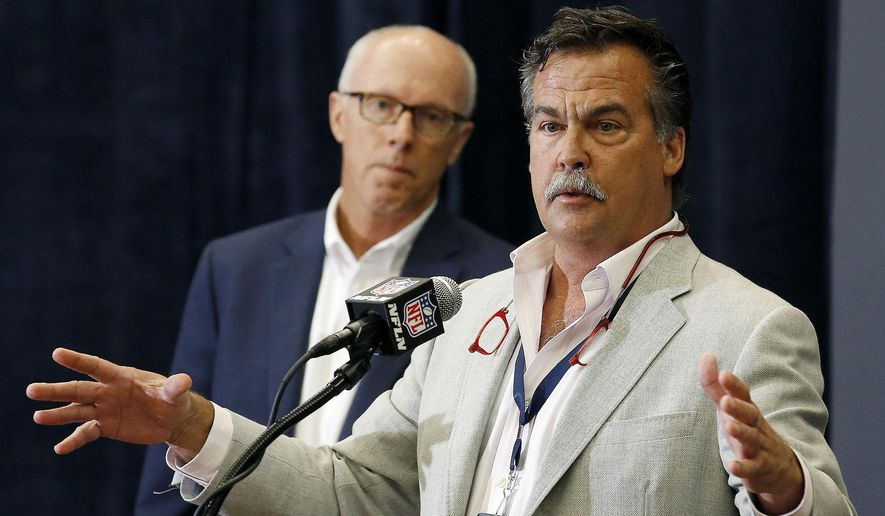 St. Louis Rams head football coach Jeff Fisher talks about the latest rules during an NFL Competition Committee news conference as Atlanta Falcons president and CEO Rich McKay, left, listens Monday, March 23, 2015, in Phoenix. (AP Photo/Ross D. Franklin)