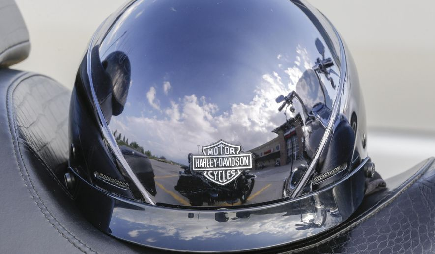 FILE - In this June 5, 2014, file photo, a Harley Davidson helmet reflects it's surrounding at Dillon Brothers Harley-Davidson in Omaha, Neb. An attempt to repeal Nebraska's motorcycle helmet law stalled on Monday, March 23, 2015, with lawmakers split over concerns for personal freedom and safety. Supporters fell nine votes short of the 33 needed to halt debate and vote on the measure. The repeal bill now falls to the bottom of this year's agenda, likely killing it for the year. (AP Photo/Nati Harnik, File)