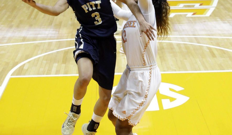 Pittsburgh guard Brianna Kiesel (3) drives against Tennessee forward Bashaara Graves (12) during the second half of a college basketball game in the second round of the NCAA women's tournament Monday, March 23, 2015, in Knoxville, Tenn. Tennessee won 77-67. (AP Photo/Mark Humphrey)