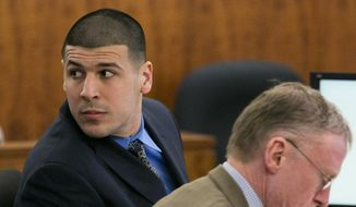 Former NFL football player Aaron Hernandez looks over his shoulder during his murder trial at Bristol County Superior Court, Monday, March 23, 2015, in Fall River, Mass. Hernandez has pleaded not guilty to murder and weapons charges in the June 2013 killing of Odin Lloyd. (AP Photo/Boston Herald, Dominick Reuter, Pool)