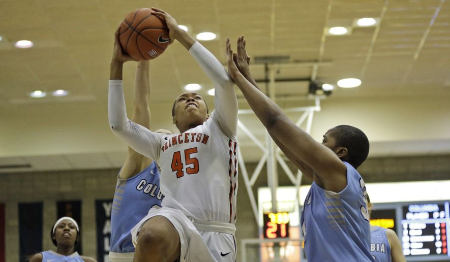 Princeton Tigers forward Leslie Robinson (45) goes up to the basket past Columbia Lions forward Amara Mbionwu (34) during the second half of an NCAA college basketball game, Saturday, March 7, 2015, in New York. Princeton won 63-44. (Associated Press)
