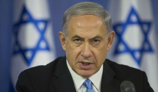 "Israel Prime Minister Benjamin Netanyahu sought to dial back his pre-election rhetoric, telling an audience in Jerusalem that he is aware that his comments had ""hurt some citizens of Israel"" and that he was ""sorry."" In urging his supporters to get out and vote, he had said Arabs were voting in ""droves"" in an effort to oust him from office. (Associated Press)"