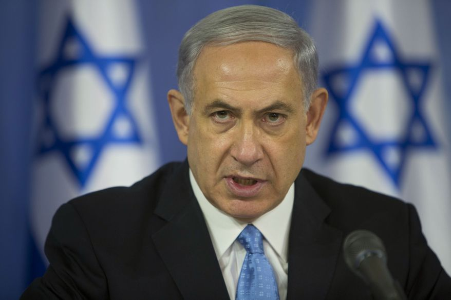 """Israel Prime Minister Benjamin Netanyahu sought to dial back his pre-election rhetoric, telling an audience in Jerusalem that he is aware that his comments had """"hurt some citizens of Israel"""" and that he was """"sorry."""" In urging his supporters to get out and vote, he had said Arabs were voting in """"droves"""" in an effort to oust him from office. (Associated Press)"""