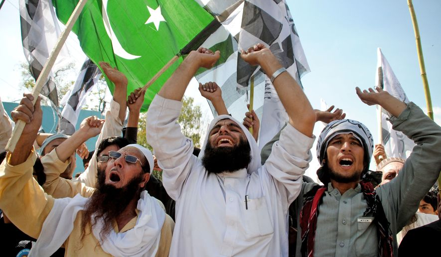 Supporters of the anti-Indian Pakistani religious group Jamat-ud-Dawa, chant slogans during a march to celebrate Pakistan's National Day, in Peshawar, Pakistan, Monday, March 23, 2015. (AP Photo/Mohammad Sajjad)