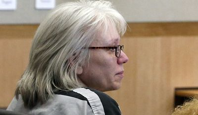FILE - In this Aug. 1, 2013, file photo, Debra Jean Milke listens to a judge during a hearing at Maricopa County Superior Court in Phoenix. A judge on Monday, March 23, 2015, dismissed the murder case against Milke, who spent more than 20 years on death row in the 1989 killing of her 4-year-old son. Judge Rosa Mroz ended the case after prosecutors lost their last appeal last week. (AP Photo/Ross D. Franklin, Pool, File)