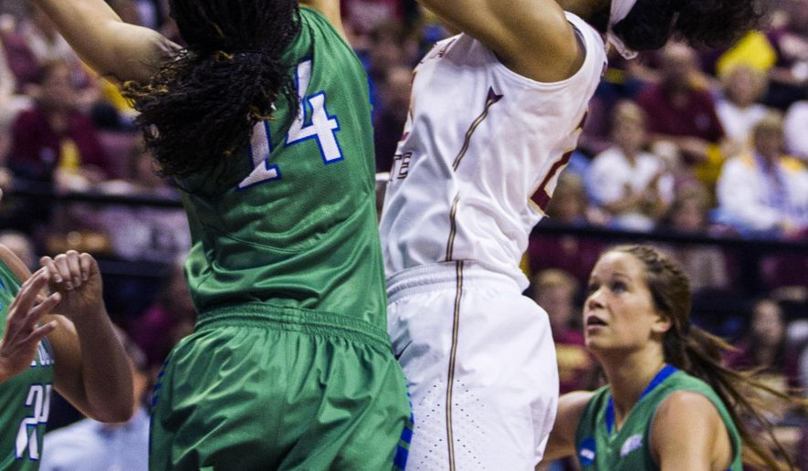 Florida State forward Ivy Slaughter has her shot blocked by Florida Gulf Coast guard Whitney Knight during the first half of a women's college basketball game in the second round of the NCAA tournament in Tallahassee, Fla., Saturday March 23, 2015. (AP Photo/Mark Wallheiser)