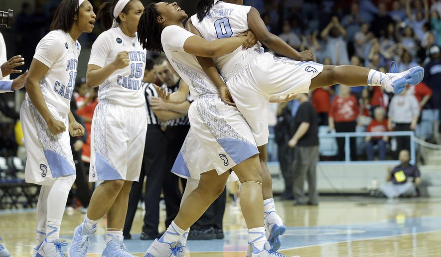 North Carolina's Hillary Fuller lifts Jamie Cherry (0) as Danielle Butts, left, and Allisha Gray (15) react following Cherry's game-winning shot against Ohio State following a women's college basketball game in the second round of the NCAA tournament, Monday, March 23, 2015, in Chapel Hill, N.C. North Carolina won 86-84. (AP Photo/Gerry Broome)