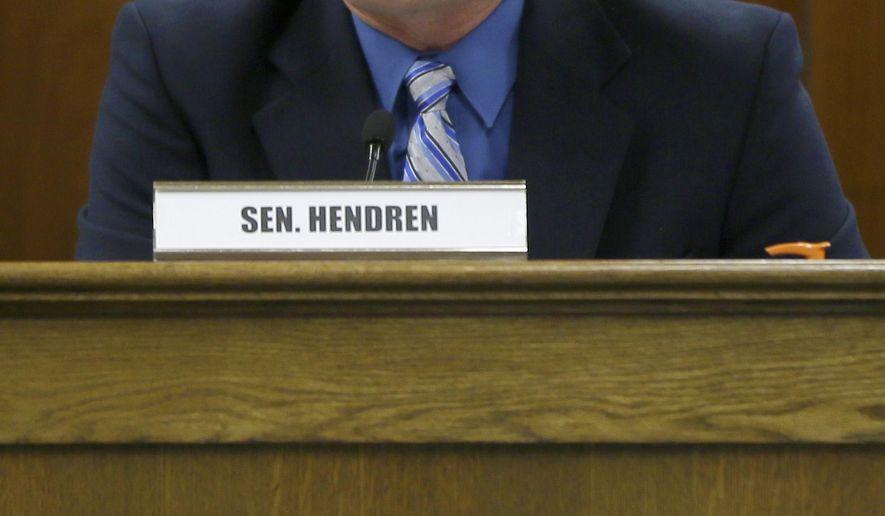 Sen. Jim Hendren, R-Gravette, presides over a meeting of the Health Reform Legislative Task Force at the Arkansas state Capitol in Little Rock, Ark., Monday, March 23, 2015. (AP Photo/Danny Johnston)
