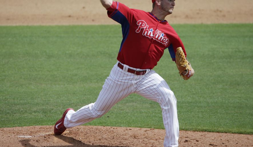 Philadelphia Phillies starting pitcher David Buchanan winds up in the third inning of a spring training baseball game against the Minnesota Twins in Clearwater, Fla., Monday, March 23, 2015. (AP Photo/Kathy Willens)