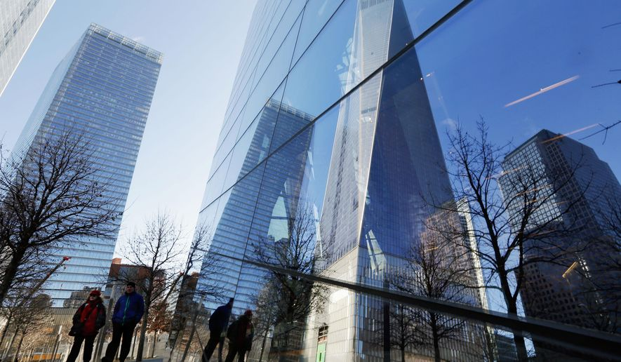 The One World Trade Center building, second from right, is reflected in the windows of the 9/11 Museum, in New York,  Monday, March 23, 2015. The first stair-climb benefit will be held at One World Trade Center in May to raise money for military veterans, two foundations, the Stephen Siller Tunnel to Towers Foundation and the Captain Billy Burke Foundation, formed after the 9/11 attacks announced Monday. (AP Photo/Richard Drew)